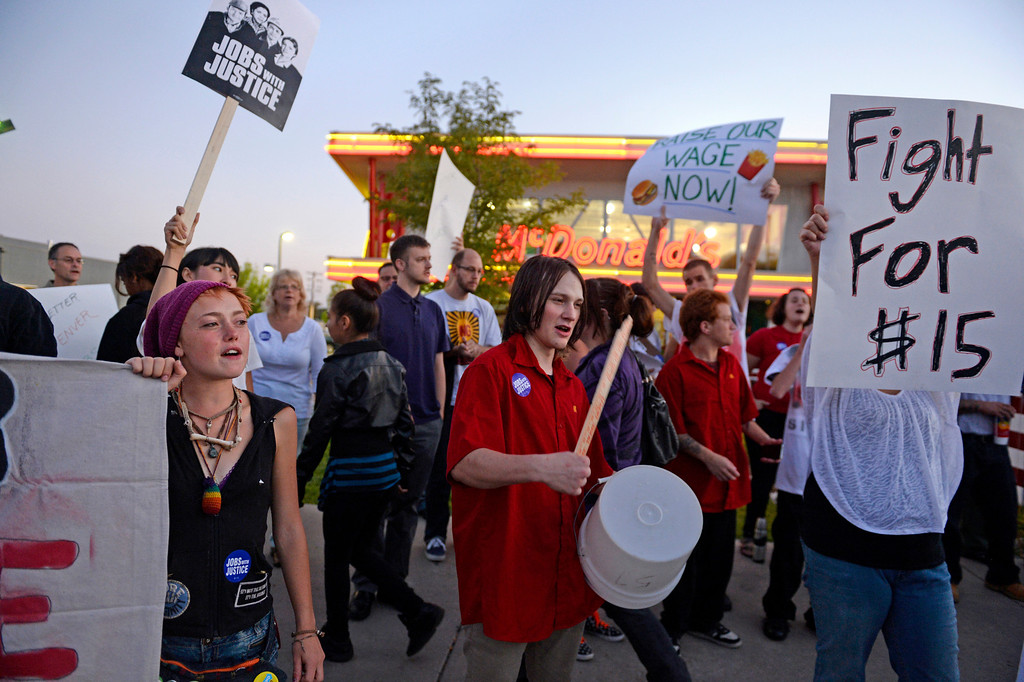Description of . NORTHGLENN, CO-August, 2013: Protesters asking for better wages for fast food workers stand outside a McDonald's in Northglenn, August 29, 2013. The asking rate is $15 an hour for workers in this nationally organized event. (Photo By RJ Sangosti/The Denver Post)