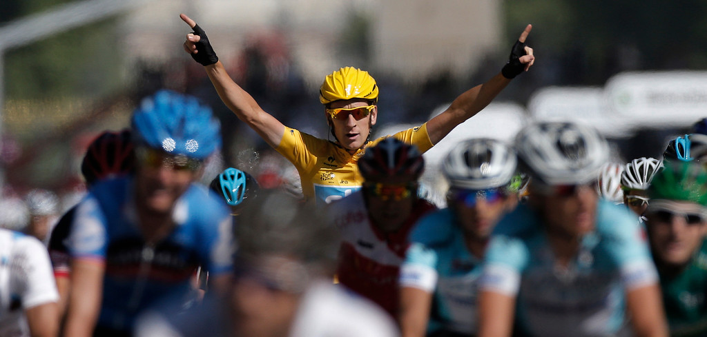 Description of . In this July 22, 2012 file photo, Bradley Wiggins, winner of the 2012 Tour de France cycling race, celebrates as he crosses the finish line of the last stage of the the Tour de France cycling race over 120 kilometers (74.6 miles) with start in Rambouillet and finish in Paris, France. (AP Photo/Laurent Rebours, File)