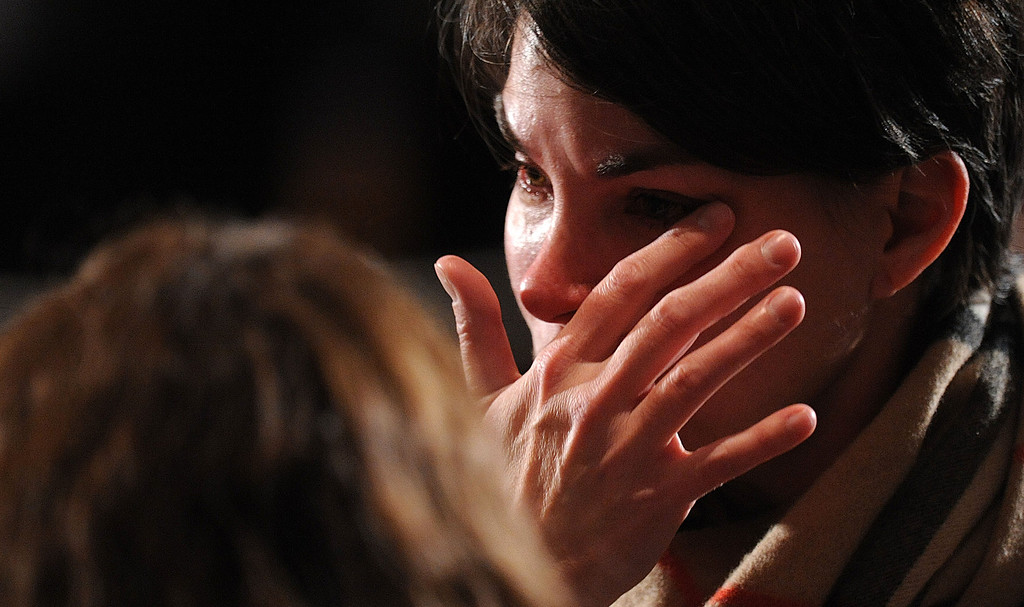 Description of . NEWTOWN, CT - DECEMBER 16:  A mourner cries before U.S. President Barack Obama speaks at an interfaith vigil for the shooting victims from Sandy Hook Elementary School on December 16, 2012 at Newtown High School in Newtown, Connecticut. Twenty-six people were shot dead, including twenty children, after a gunman identified as Adam Lanza opened fire at Sandy Hook Elementary School. Lanza also reportedly had committed suicide at the scene. A 28th person, believed to be Nancy Lanza, found dead in a house in town, was also believed to have been shot by Adam Lanza. (Photo by Olivier Douliery-Pool/Getty Images)