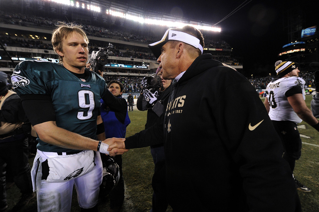. PHILADELPHIA, PA - JANUARY 04:  (L-R) Nick Foles #9 of the Philadelphia Eagles talks with head coach Sean Payton of the New Orleans Saints after their NFC Wild Card Playoff game at Lincoln Financial Field on January 4, 2014 in Philadelphia, Pennsylvania. The New Orleans Saints defeated the Philadelphia Eagles 26 - 24.  (Photo by Maddie Meyer/Getty Images)