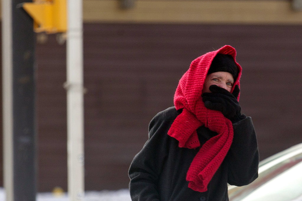 Description of . A pedestrian braves the cold as temperatures remain in the negative digits on January 7, 2014 in Milwaukee, Wisconsin. A 'polar vortex' of frigid air centered on the North Pole dropped temperatures to the negative double digits at its worst. (Photo by Darren Hauck/Getty Images)