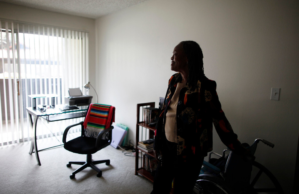 Description of . Barbara Dunlap, 61, who is an outpatient at Prototypes residential treatment program, stands in her home in Pomona, California, March 26, 2013. Prototypes is part of the Second Chance Women's Re-entry Court program, one of the first in the U.S. to focus on women. It offers a cost-saving alternative to prison for women who plead guilty to non-violent crimes and volunteer for treatment. Of the 297 women who have been through the court since 2007, 100 have graduated, and only 35 have been returned to state prison. Picture taken March 26, 2013. REUTERS/Lucy Nicholson