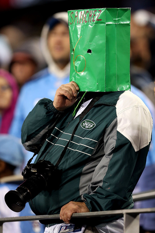 Description of . NASHVILLE, TN - DECEMBER 17:  A New York Jets fans wears a green bag over his head with Sanchez and the #6 on it against the Tennessee Titans at LP Field on December 17, 2012 in Nashville, Tennessee.  (Photo by Andy Lyons/Getty Images)