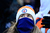 Broncos fans try to keep warm in the stands. The Denver Broncos vs Baltimore Ravens AFC Divisional playoff game at Sports Authority Field Saturday January 12, 2013. (Photo by AAron  Ontiveroz,/The Denver Post)