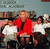 First lady Hillary Rodham Clinton reacts to a Cleveland Tri-School Learning Academy student Friday, Feb. 14, 1997, in Washington, while sitting with students Myesha Lowe, right, and Paul Ragan.  Clinton and retired Gen. Julius Becton, CEO of DC public schools, discussed Black History Month during their visit to the school.  (AP Photo/Karin Cooper)