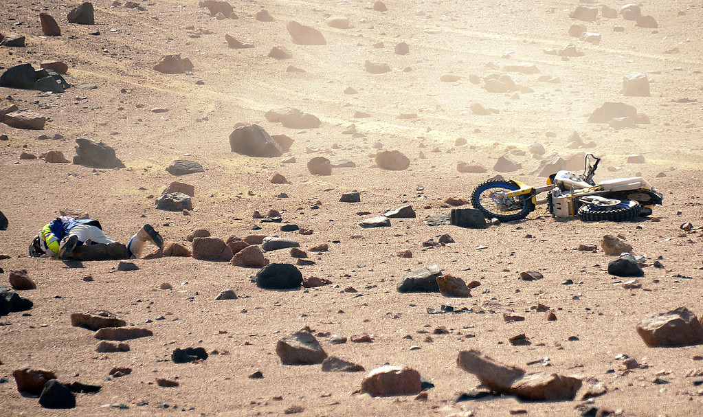 Description of . The Netherlands´ Henno Van Bergeijk is seen on the ground after falling during Stage 3 of the Dakar Rally 2013 between Pisco and Nazca, Peru, on January 7, 2013. The rally will take place in Peru, Argentina and Chile from January 5-20.  FRANCK FIFE/AFP/Getty Images
