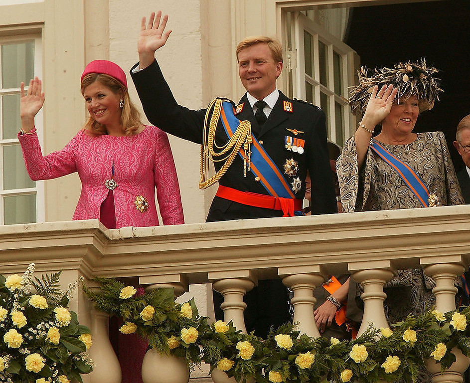 Description of . Princess Maxima, Prince Willem Alexander and Queen Beatrix wave to the gathered crowds from the balcony September 16, 2003 in The Hague, Netherlands. Queen Beatrix traditionally gives a speech to mark the state opening of parliament in the presence of members of the Dutch government and the rest of the Dutch Royal family at the Binnenhof in The Hague. (Photo by Mark Renders/Getty Images)