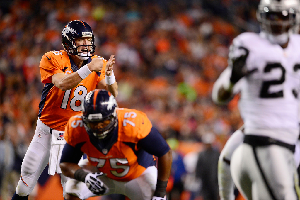 Description of . Denver Broncos quarterback Peyton Manning (18) calls a play from the line in the second quarter. The Denver Broncos took on the Oakland Raiders at Sports Authority Field at Mile High in Denver on September 23, 2013. (Photo by AAron Ontiveroz/The Denver Post)