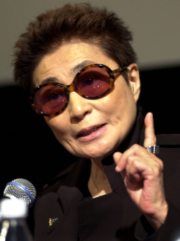 Description of . Artist Yoko Ono addresses members of the media during a news conference on the campus of the Massachusetts Institute of Technology, in Cambridge, Mass., Friday, Oct. 19, 2001, held as part of an introduction to Ono's first American retrospective exhibit. The show, called