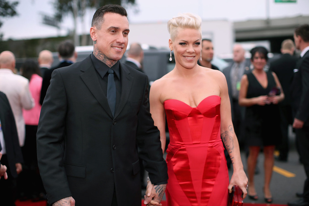 Description of . Off-road truck racer Carey Hart and singer Pink attend the 56th GRAMMY Awards at Staples Center on January 26, 2014 in Los Angeles, California.  (Photo by Christopher Polk/Getty Images for NARAS)