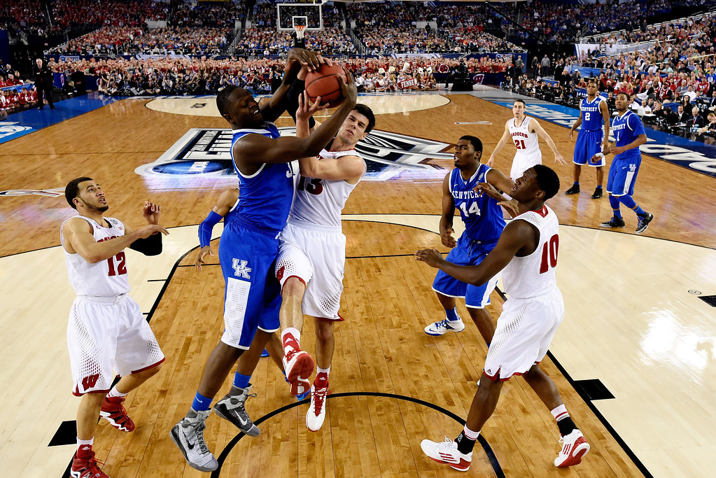 Description of . ARLINGTON, TX - APRIL 05:  Julius Randle #30 of the Kentucky Wildcats and Duje Dukan #13 of the Wisconsin Badgers battle for a rebound during the NCAA Men's Final Four Semifinal at AT&T Stadium on April 5, 2014 in Arlington, Texas. (Photo by Chris Steppig-Pool/Getty Images)