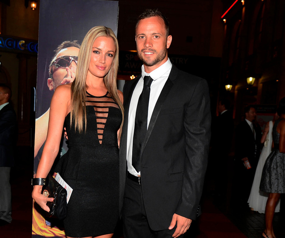 Description of . Oscar Pistorius (R) and his girlfriend Reeva Steenkamp pose for a picture in Johannesburg, February 7, 2013. South African