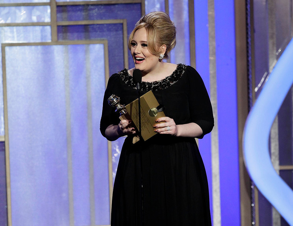 Description of . This image released by NBC shows singer Adele, winner of the award for best original song for