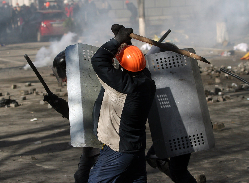 Description of . Protesters clash with riot police in Kiev on February 18, 2014. Police on Tuesday fired rubber bullets at stone-throwing protesters as they demonstrated close to Ukraine's parliament in Kiev, an AFP reporter at the scene said. Police also responded with smoke bombs after protesters hurled paving stones at them as they sought to get closer to the heavily-fortified parliament building. AFP PHOTO/ ANATOLII  BOIKO/AFP/Getty Images