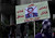 A woman carries a sign with a photo of Egyptian President Mohammed Morsi and Arabic that reads,