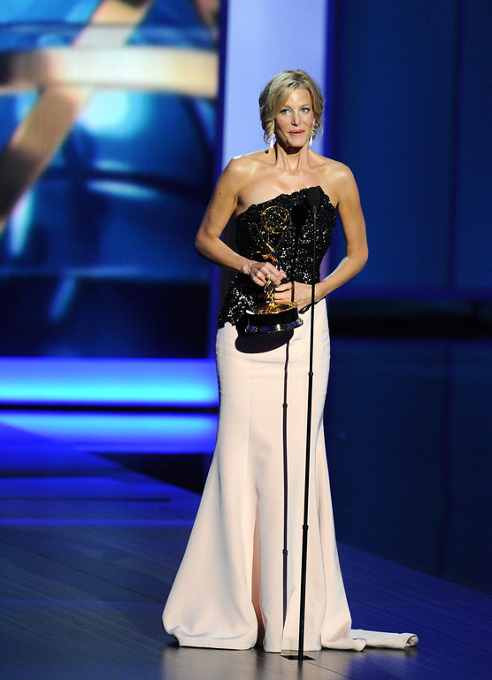 Description of . Winner of Best Supporting Actress in a Drama Series, Anna Gunn speaks onstage during the 65th Annual Primetime Emmy Awards held at Nokia Theatre L.A. Live on September 22, 2013 in Los Angeles, California.  (Photo by Kevin Winter/Getty Images)