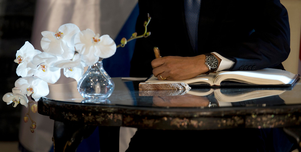 Description of . President Barack Obama signs a guest book, Wednesday, March 20, 2013, at the residence of Israeli President Shimon Peres in Jerusalem. (AP Photo/Carolyn Kaster)