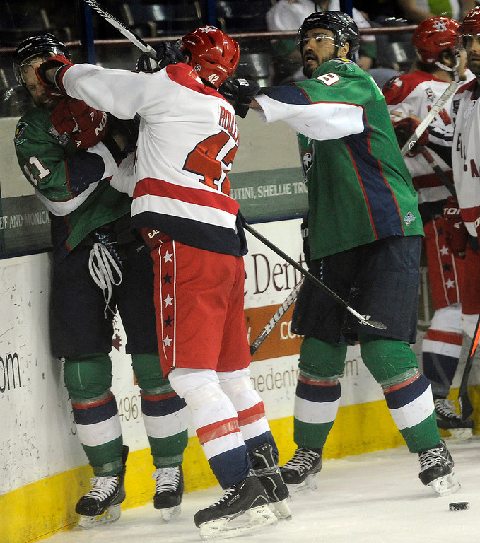 Description of . DENVER, CO - MAY 2: Jean-Phillipp Chabot (11) of the Denver Cutthroats gets punched in the face by Ross Rouleau (42) of the Allen Americans during the first period of game 1 of the Ray Miron Presidents Cup Finals at the Denver Coliseum in Denver, Colorado on May 2, 2014. (Photo by Seth McConnell/The Denver Post)