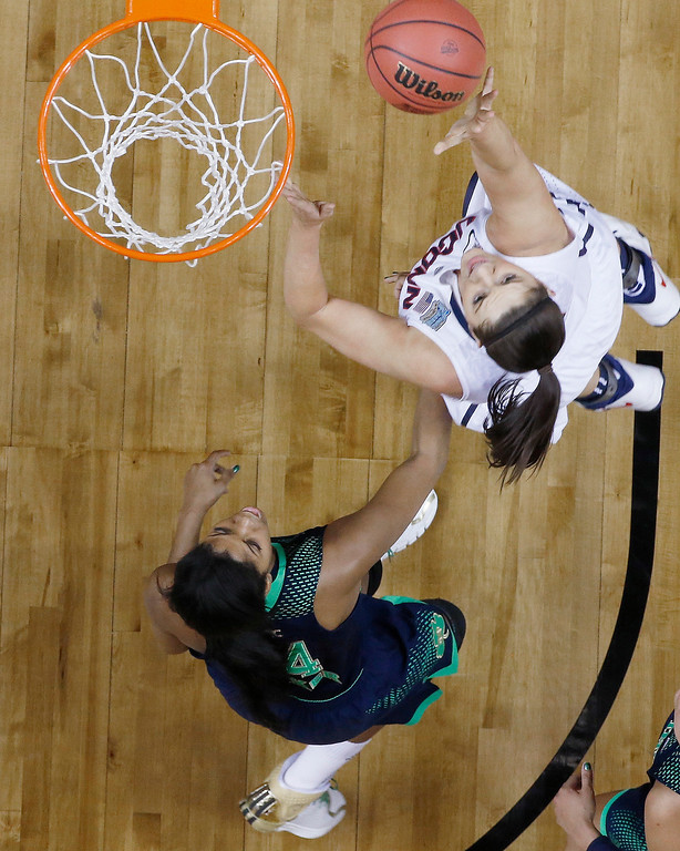 Description of . Connecticut center Stefanie Dolson (31) shoots against Notre Dame forward Ariel Braker (44)  during the first half of the championship game in the Final Four of the NCAA women's college basketball tournament, Tuesday, April 8, 2014, in Nashville, Tenn. (AP Photo/John Bazemore)