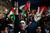Palestinians celebrate as they watch a screen showing the U.N. General Assembly votes on a resolution to upgrade the status of the Palestinian Authority to a nonmember observer state, In the west bank city of Ramallah, Thursday, Nov. 29, 2012.  The U.N. General Assembly has voted by a more than two-thirds majority to recognize the state of Palestine. The resolution upgrading the Palestinians' status to a nonmember observer state at the United Nations was approved by the 193-member world body late Thursday by a vote of 138-9 with 41 abstentions. (AP Photo/Majdi Mohammed)
