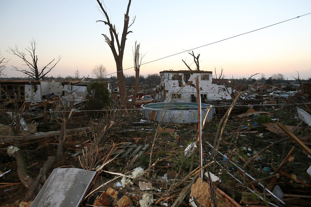 Description of . Damaged buildings along Washington Road in the aftermath of a tornado on November 18, 2013 in Washington, Illinois. A fast-moving storm system that produced several tornadoes that touched down across the Midwest left behind a path of destruction in 12 states.  (Photo by Tasos Katopodis/Getty Images)