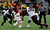 Seth Doege #7 of Texas Tech is sacked by Ra'Shede Hageman #99 of Minnesota during the Meineke Car Care of Texas Bowl at Reliant Stadium on December 28, 2012 in Houston, Texas.  (Photo by Scott Halleran/Getty Images)