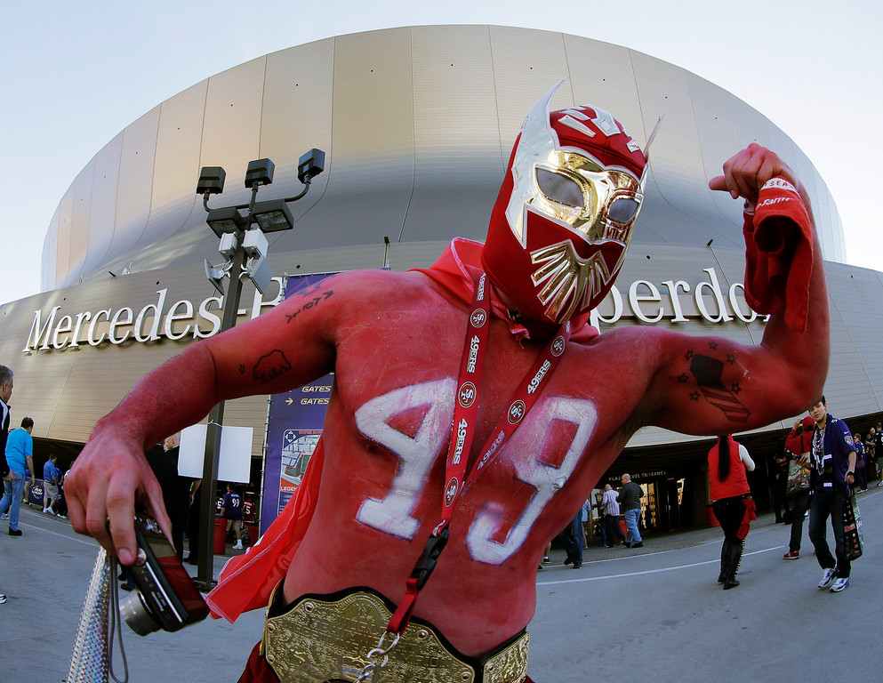 Description of . San Francisco 49ers fan Ramiro Munoz, of Fresno, Calif., poses for a photo before the NFL Super Bowl XLVII football game between the 49ers and the Baltimore Ravens, Sunday, Feb. 3, 2013, in New Orleans. (AP Photo/Charlie Riedel)