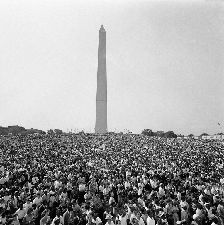 Description of . Mass of demonstrators leave the Washington Monument, background, for the March on Washington parade to the Lincoln Memorial, Aug. 28, 1963. (AP Photo)