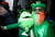 Dennis O'Mann and his doll watch the St. Patrick's Day Parade in New York, March 16, 2013.  REUTERS/Carlo Allegri