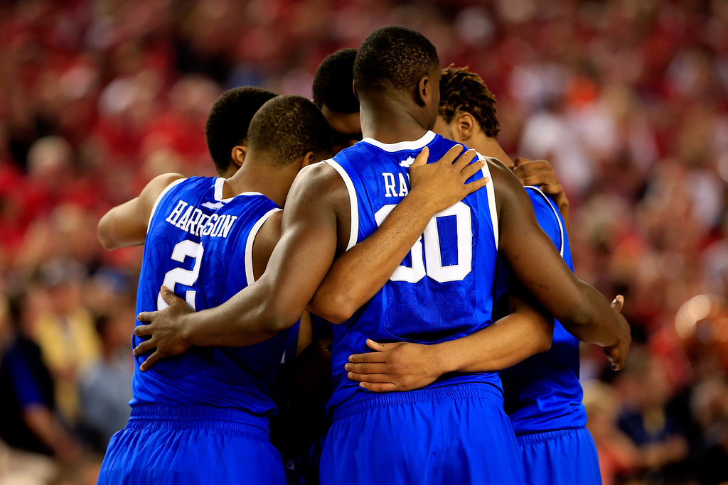 Description of . ARLINGTON, TX - APRIL 05: The Kentucky Wildcats huddle before the NCAA Men's Final Four Semifinal against the Wisconsin Badgers at AT&T Stadium on April 5, 2014 in Arlington, Texas.  (Photo by Jamie Squire/Getty Images)