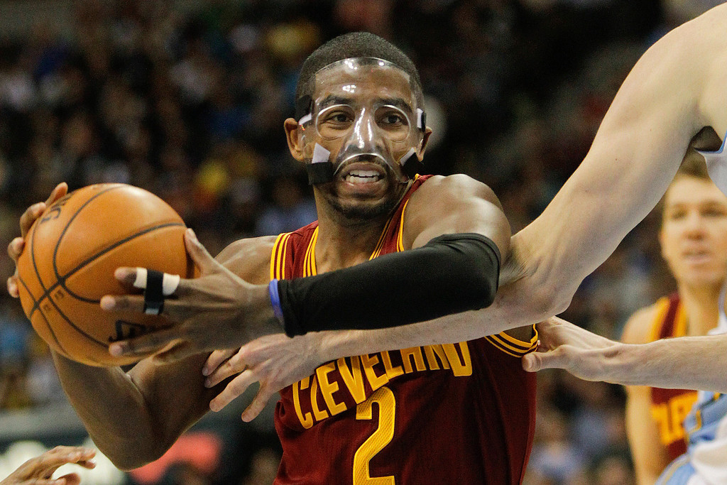 Description of . Cleveland Cavaliers' Kyrie Irving drive to the basket during the third quarter of an NBA basketball game against the Denver Nuggets Friday, Jan. 11, 2013, in Denver. The Nuggets won 98-91 (AP Photo/Barry Gutierrez)