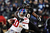Quarterback Eli Manning #10 of the New York Giants is pulled down by linebacker Dannell Ellerbe #59 of the Baltimore Ravens in the first quarter at M&T Bank Stadium on December 23, 2012 in Baltimore, Maryland. (Photo by Patrick Smith/Getty Images)