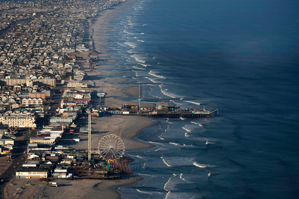Description of . The Funtown Pier is seen in the foreground in this aerial view of Seaside Heights, New Jersey, almost a month since the area was hit by Hurricane Sandy, November 28, 2012.   REUTERS/Adrees Latif