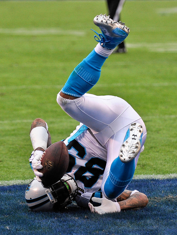 Description of . Carolina Panthers wide receiver Steve Smith tumbles into the end zone with a touchdown reception against the San Diego Chargers during the second half of a NFL football game Sunday, Dec. 16, 2012, in San Diego. (AP Photo/Denis Poroy)
