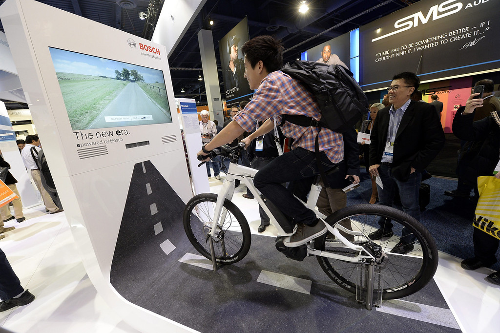 Description of . An attendee rides a bicycle equipped with Bosch sensors and a interactive cycling screen at the Las Vegas Convention Center for the 2014 International CES (Consumer Electronics Show) in Las Vegas, Nevada, USA, 08 January 2014. CES, the world's largest annual consumer technology trade show, runs from 7-10 January and is expected to feature 3,200 exhibitors displaying their latest products and services to about 150,000 attendees.  EPA/MICHAEL NELSON