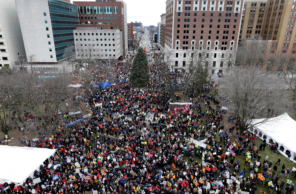 Description of . Protesters gather for a rally outside the State Capitol in Lansing, Mich., Tuesday, Dec. 11, 2012. The crowd is protesting right-to-work legislation passed last week. Michigan could become the 24th state with a right-to-work law next week. Rules required a five-day wait before the House and Senate vote on each other\'s bills; lawmakers are scheduled to reconvene Tuesday and Gov. Snyder has pledged to sign the bills into law. (AP Photo/Paul Sancya)