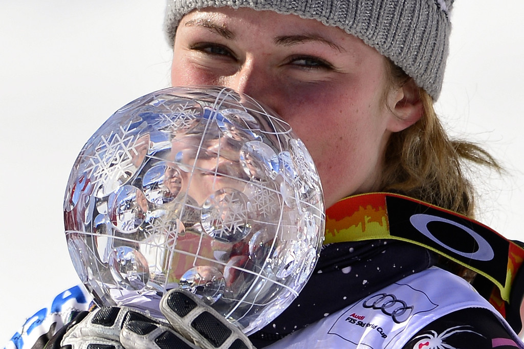 Description of . Mikaela Shiffrin of the US celebrates after winning the Women Slalom race and the crystal Globe trophy at the Alpine ski World Cup finals on March 16, 2013 in Lenzerheide. AFP PHOTO / FABRICE COFFRINI/AFP/Getty Images