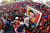 Supporters of Venezuela's late President Hugo Chavez wait for a chance to view his body at the military academy in Caracas March 8, 2013. REUTERS/Carlos Garcia Rawlins