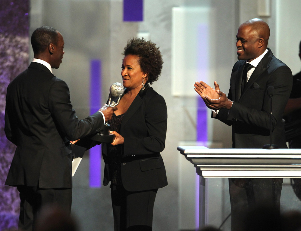 "Description of . Wanda Sykes, center, and Wayne Brady, right, present Don Cheadle the award for outstanding actor in a comedy series for ""House of Lies\"" onstage at the 44th Annual NAACP Image Awards at the Shrine Auditorium in Los Angeles on Friday, Feb. 1, 2013. (Photo by Matt Sayles/Invision/AP)"