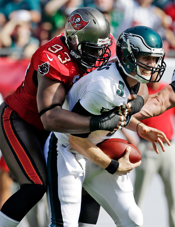 Description of . Tampa Bay Buccaneers defensive tackle Gerald McCoy (93) sacks Philadelphia Eagles quarterback Nick Foles (9) during the first quarter of an NFL football game, Sunday, Dec. 9, 2012, in Tampa, Fla. (AP Photo/Chris O\'Meara)