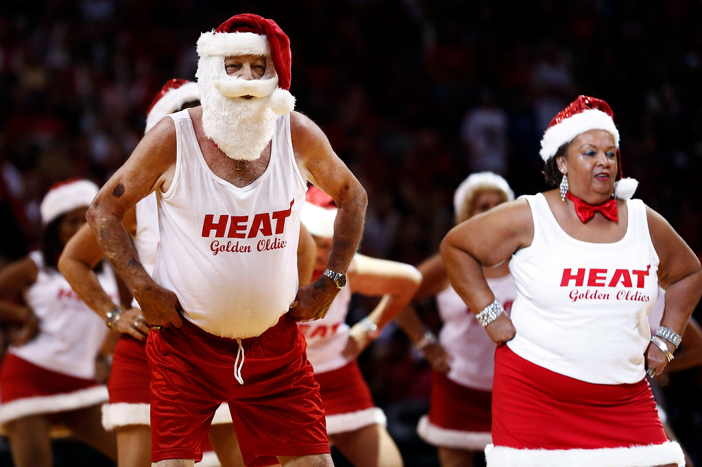 Description of . The Miami Heat Golden Oldies perform during the first half of an NBA basketball game between the Heat and the Oklahoma City Thunder, Tuesday, Dec. 25, 2012, in Miami. (AP Photo/J Pat Carter)