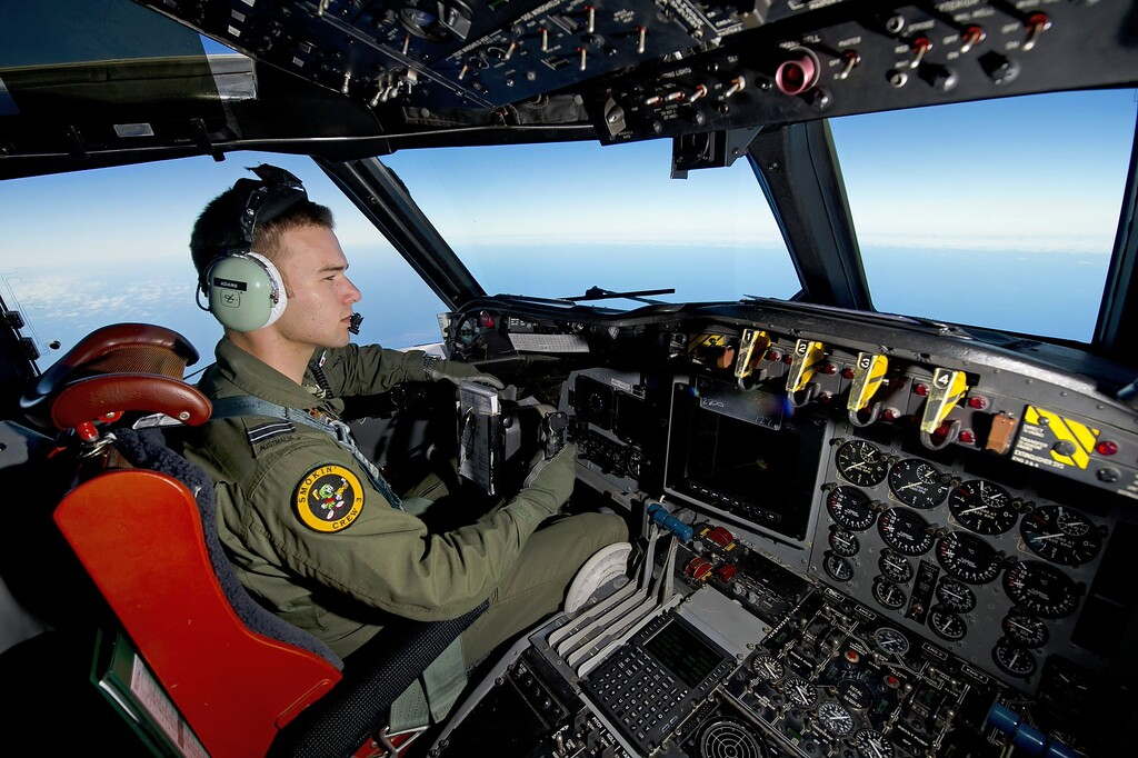 Description of . A handout photo taken on March 19, 2014 shows Royal Australian Air Force pilot Flight Lieutenant Russell Adams from 10 Squadron, flying his AP-3C Orion over the Southern Indian Ocean during the search for missing Malaysian Airlines flight MH370.  Two objects possibly related to the search for missing Malaysia Airlines flight MH370 have been sighted in the southern Indian Ocean, Australian Prime Minister Tony Abbott said in a potential breakthrough on March 20, 2014.  Abbott told parliament