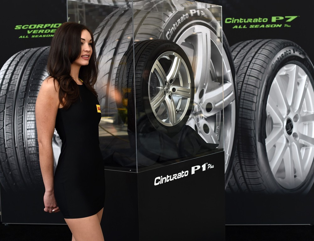 . A model shows off the Pirelli Cinturato P1 plus tires during the second press preview day at the 2014 New York International Auto Show  April 17, 2014  in New York at the Jacob Javits Center. AFP PHOTO / Timothy A. CLARY/AFP/Getty Images