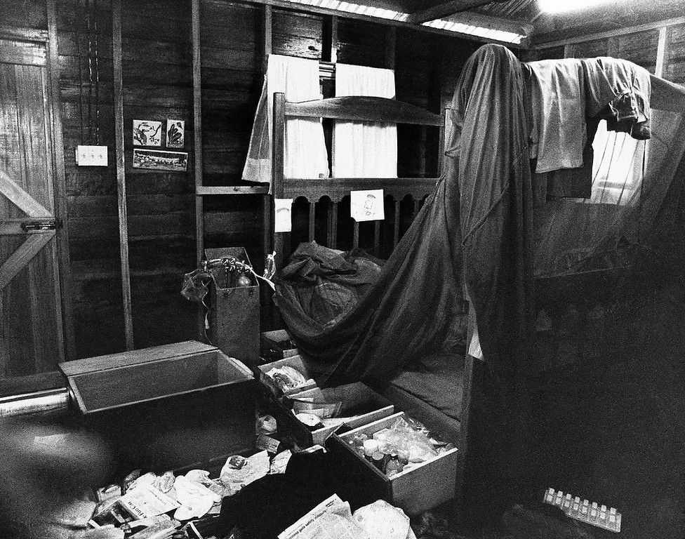Description of . The bedroom of Cult leader Rev. Jim Jones, on Nov. 26, 1978, in Jonestown, Guyana. Jones led the cult in a mass suicide that resulted in more than 900 deaths claiming they would be transported to another planet where they would live in peace in a new eden avoiding the nuclear fire that would engulf the earth. (AP Photo/Val Maaenga)