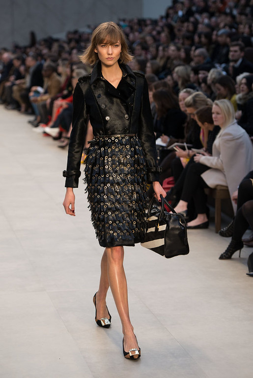 Description of . Karlie Kloss walks the runway during the Burberry Prorsum show during London Fashion Week Fall/Winter 2013/14 at Kensington Gardens on February 18, 2013 in London, England. (Photo by Ian Gavan/Getty Images)