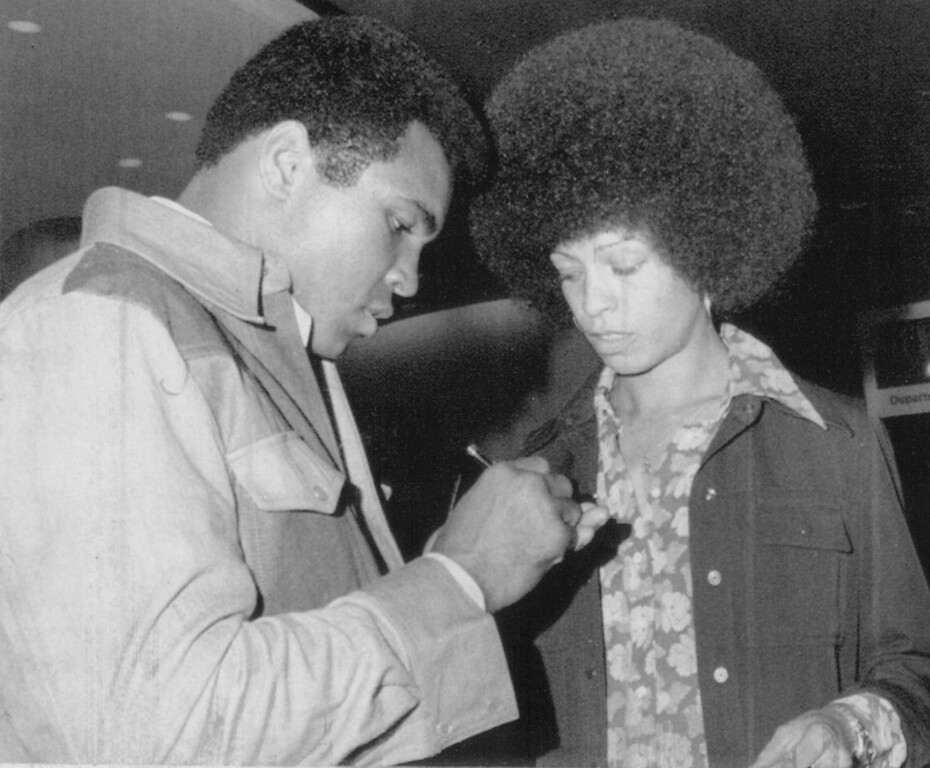 Description of . Angela Davis With Muhammad Ali in 1974. Denver post Library Archive