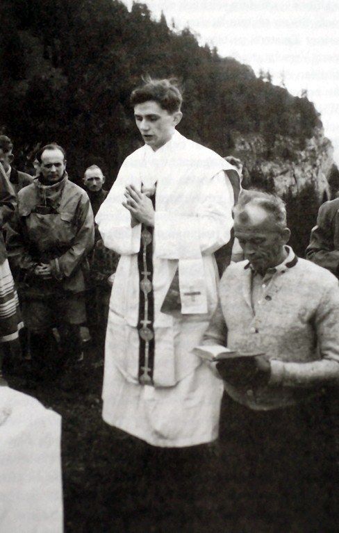 Description of . A photo taken during the summer 1952 near Ruhpolding, shows German priest Joseph Ratzinger (C) praying during a open-air mass. German Cardinal Joseph Ratzinger was elected the 265th pope of the Roman Catholic Church 19 April 2005 at the Vatican City, becoming Pope Benedict XVI. KNA-BILD/AFP/Getty Images