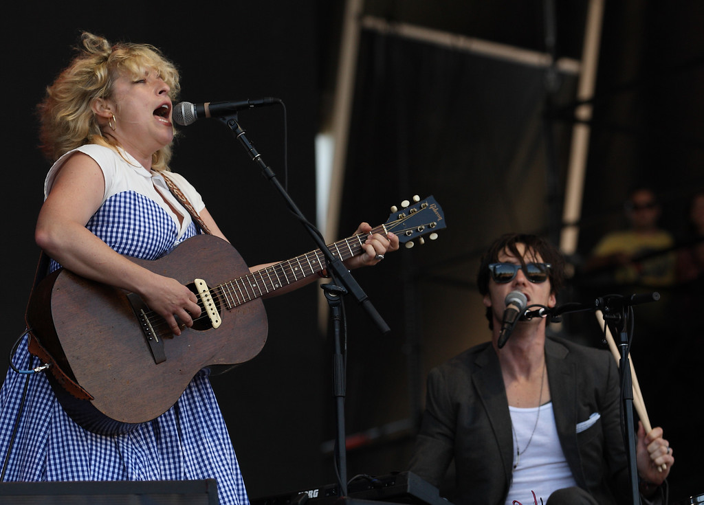 Description of . Cary Ann Hearst, left, and Michael Trent of the duo Shovels & Rope on day 2 of Lollapalooza 2013 at Grant Park on Saturday, Aug. 3, 2013 in Chicago. (Photo by Steve Mitchell/Invision/AP)