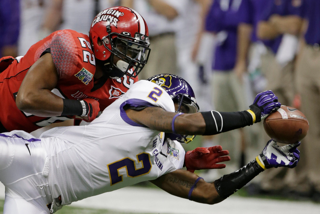 Description of . Louisiana-Lafayette cornerback Melvin White (22) breaks up a pass to East Carolina wide receiver Justin Hardy (2) in the first half of the New Orleans Bowl, an NCAA college football game in New Orleans, Saturday, Dec. 22, 2012. (AP Photo/Dave Martin)