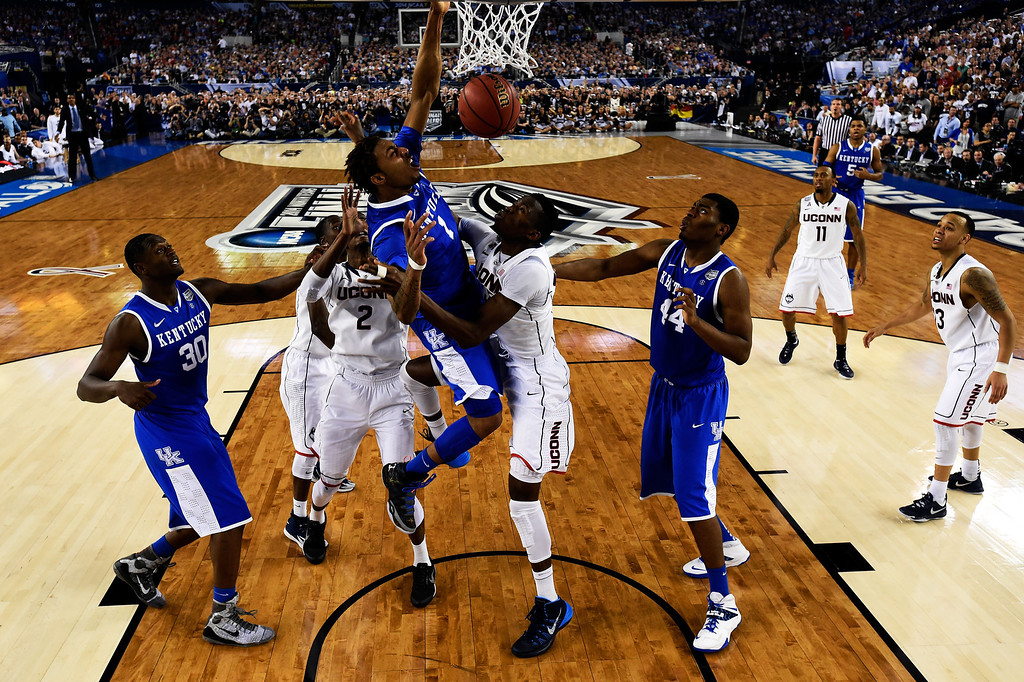 Description of . ARLINGTON, TX - APRIL 07:  James Young #1 of the Kentucky Wildcats dunks over Amida Brimah #35 of the Connecticut Huskies during the NCAA Men\'s Final Four Championship at AT&T Stadium on April 7, 2014 in Arlington, Texas. (Photo by Chris Steppig-Pool/Getty Images)